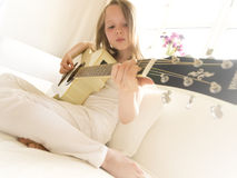 Young Girl on a Acoustic Guitar 6 Stock Photo