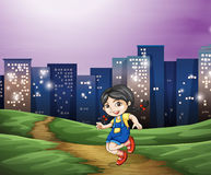 A young girl across the tall buildings in the city Royalty Free Stock Photo