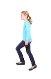 Young girl action of stepping up Royalty Free Stock Image