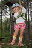 Young girl in adventure park Royalty Free Stock Images