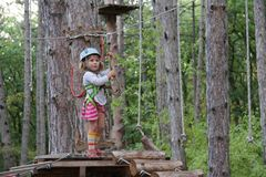 Young girl in adventure park Stock Photos
