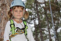 Young girl in adventure park Stock Image