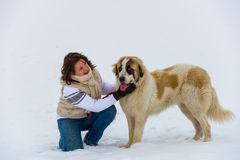 Young girl affection moment with her shepherd dog in the winter time royalty free stock photo