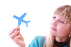 Young girl with aircraft in hands Royalty Free Stock Images