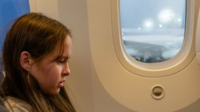 Young girl on airplane stock image