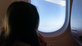 Young girl on airplane royalty free stock photography