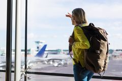 Young girl in airport ready for new adventures Stock Photography