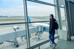 Young girl at the airport terminal Stock Images
