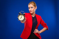 Young girl with an alarm clock in focus Stock Photo