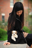 Young Girl And Baby Dog Stock Photography