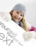 Young Girl And Blank Advertisement Paper Royalty Free Stock Photos