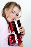 The young girl an angel with gifts Stock Photography