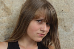 Young girl with angry expressionl. look down Royalty Free Stock Photos