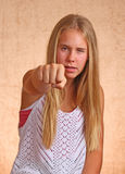 Young Girl With Angry Fist Stock Photography