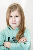 Young girl with an angry look and crossed arms Stock Photo