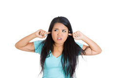 Young girl annoyed and trying to shut the loud noise Royalty Free Stock Images