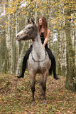 Young girl with appaloosa horse in autumn Stock Photo