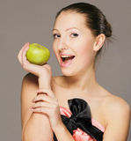 Young girl with apple stock image