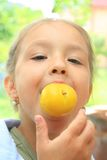 Young girl with an apple stock photo