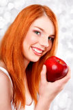 Young girl with an apple Stock Image
