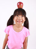Young girl with apple Royalty Free Stock Photos