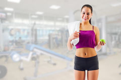 Young girl with apple at gym club Royalty Free Stock Photo