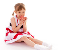 Young girl with an apple. Royalty Free Stock Image
