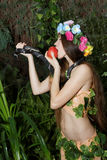 Young girl with apple and snake Royalty Free Stock Images