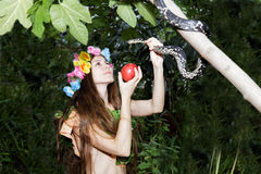 Young girl with apple and snake Stock Photo