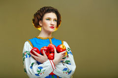 Young girl with apples Stock Photo