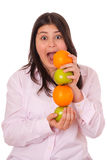 Young girl with apples and oranges Stock Images