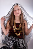 Young girl with arab shawl Royalty Free Stock Images