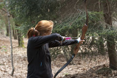 Young girl archer  competitor in scout category Royalty Free Stock Photos