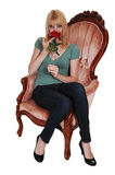 Young girl in armchair. Stock Photography
