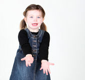 Young girl with arms extended. On white Royalty Free Stock Image