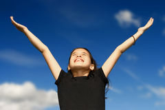 Young girl arms wide open stock image