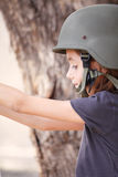 Young girl with army hat Royalty Free Stock Photography