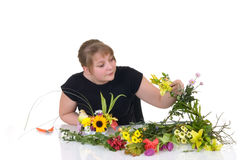 Young girl arranging flowers Royalty Free Stock Image