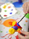 Young Girl Artist Painting Stock Photo