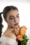 Young girl with artistic make up Stock Photo
