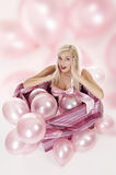 Young girl as a gift in balloons Royalty Free Stock Image