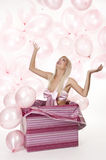 Young girl as a gift in balloons Royalty Free Stock Images