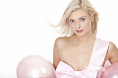 Young girl as a gift in balloons Stock Image