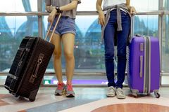Young girl asian together backpack aiport. Young girl asian together backpack with carrying hold suitcase luggage and passenger for tour travel booking ticket stock images