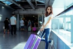 Young girl asian traveler hipster with carrying. Hold suitcase luggage and passenger for tour travel booking ticket flight in airport international vacation royalty free stock photography