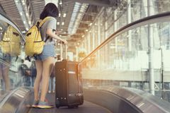 Young girl asian traveler holding phone with carrying. Hold suitcase luggage and passenger for tour travel booking ticket flight in airport international royalty free stock photos