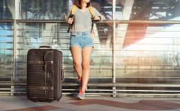 Young girl asian traveler standing with carrying. Hold suitcase luggage and passenger for tour travel booking ticket flight in airport international vacation stock photography