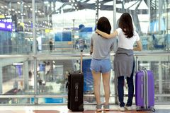 Young girl asian traveler together backpack. With carrying hold suitcase luggage and passenger for tour travel booking ticket flight in airport international royalty free stock image