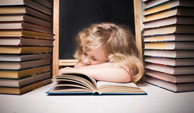 Young girl asleep on book Royalty Free Stock Photography