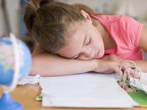 Young Girl Asleep On Her Homework Stock Photos